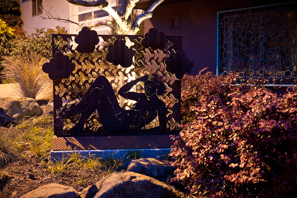 By uplighting the tree and backlighting the sculpture, we tastefully silhouette the reclining nude.