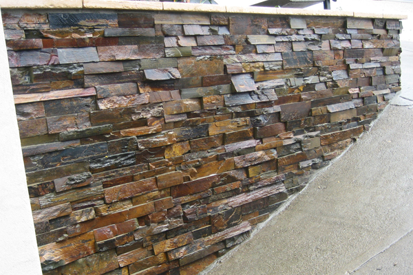 A fresh veneer of slate really brightened up this formerly dilapidated brick wall.
