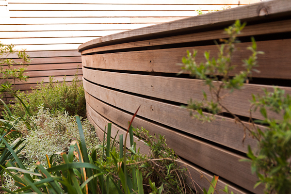 A gentlly curved facade softens the edges of the retaining wall.